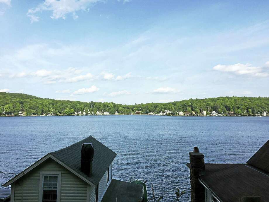Highland Lake in Winsted, as seen Tuesday. The Planning and Zoning Commission voted Monday to eliminate a regulation governing the expansion of existing nonconforming properties, including those around the lake. Photo: Ben Lambert — The Register Citizen