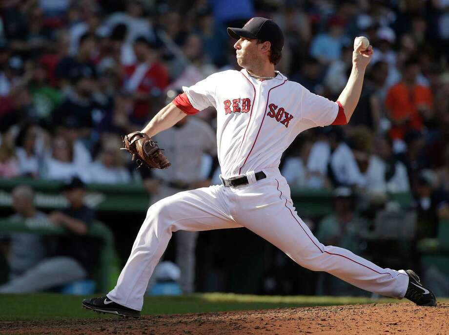 Boston Red Sox reliever Craig Breslow has re-signed with the team. Photo: Steven Senne — The Associated Press File Photo  / AP