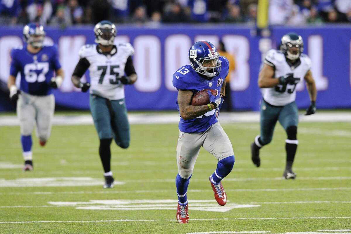 New York Giants receiver Odell Beckham runs away from the Philadelphia Eagles' Mychal Kendricks (95) and Vinny Curry (75) for a touchdown during a Dec. 28 game in East Rutherford, N.J.