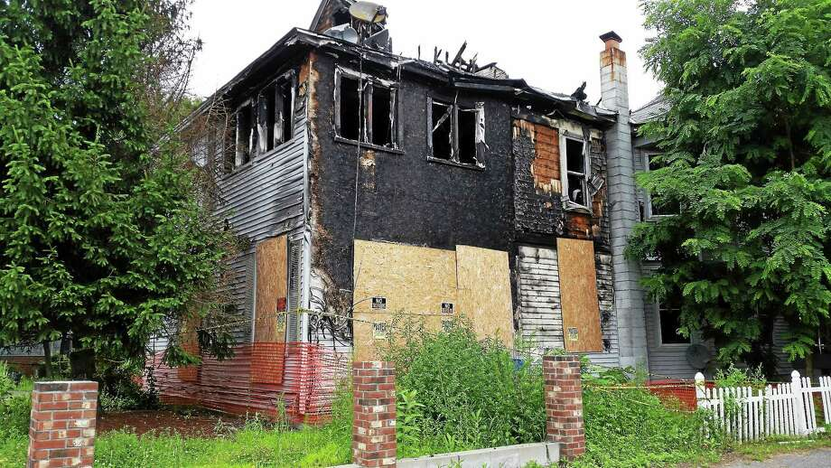Safety concerns about the blighted property at 408 Main St. in Torrington were discussed at Wednesday's public safety meeting. Photo: Amanda Webster — The Register Citizen