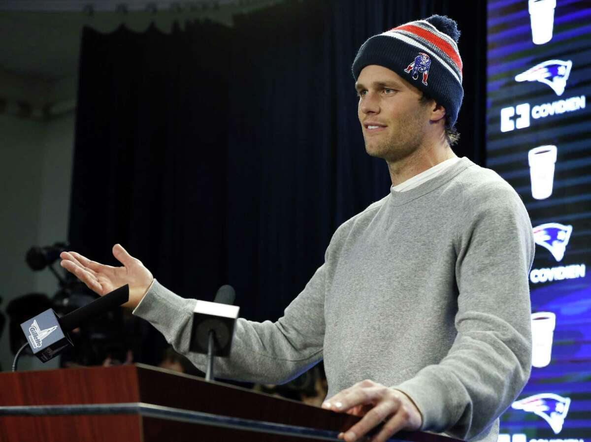 """An NFL investigation has found that New England Patriots employees likely deflated footballs and quarterback Tom Brady was """"at least generally aware"""" of the rules violations. The 243-page report released Wednesday said league investigators found no evidence coach Bill Belichick and team management knew of the practice."""