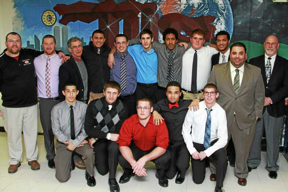 Torrington seniors and coaches at the Red Raidersí football banquet are front row, left to right: Dylan Rodriguez; Anthony Pandolfo; Mike Montanez; Frank Perry; P.J. Killmartin. Back row, left to right: Coach Andy Therriault; Coach Jordan Capitanio; Coach Bob Reynolds; Bryan Rocha; Dylan Heller; Adam Klebe; Ludi Perez; Ben Bonvicini; Manny Rijo; Head Coach Gaitan Rodriguez; Coach Don Whitley. Photo: Marianne Killackey — Special To The Register Citizen  / 2014