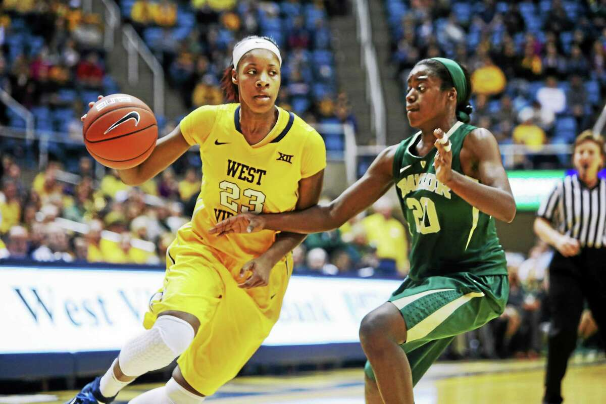 West Virginia guard Bria Holmes drives to the basket against Baylor guard Imani Wright during a January game in Morgantown, W.Va.