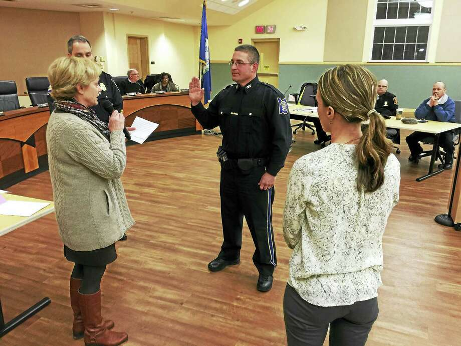 Sgt. William Bernabucci was recognized Wednesday evening for his recent promotion, as he was honored with a pinning ceremony at a meeting of the Board of Public Safety. Photo: BEN LAMBERT — The Register Citizen