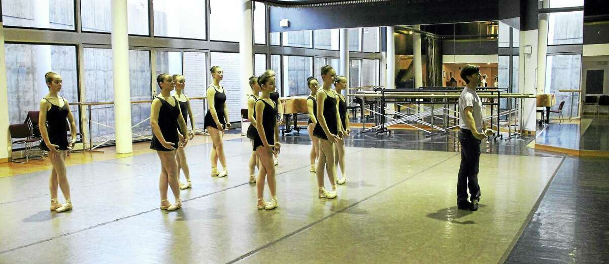 Tom Gold, right, and advanced students work on a piece at New Haven Ballet studios on Audubon Street.