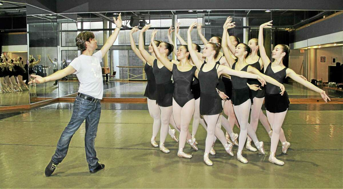 Guest choreographer Tom Gold, left, and New Haven Ballet students.