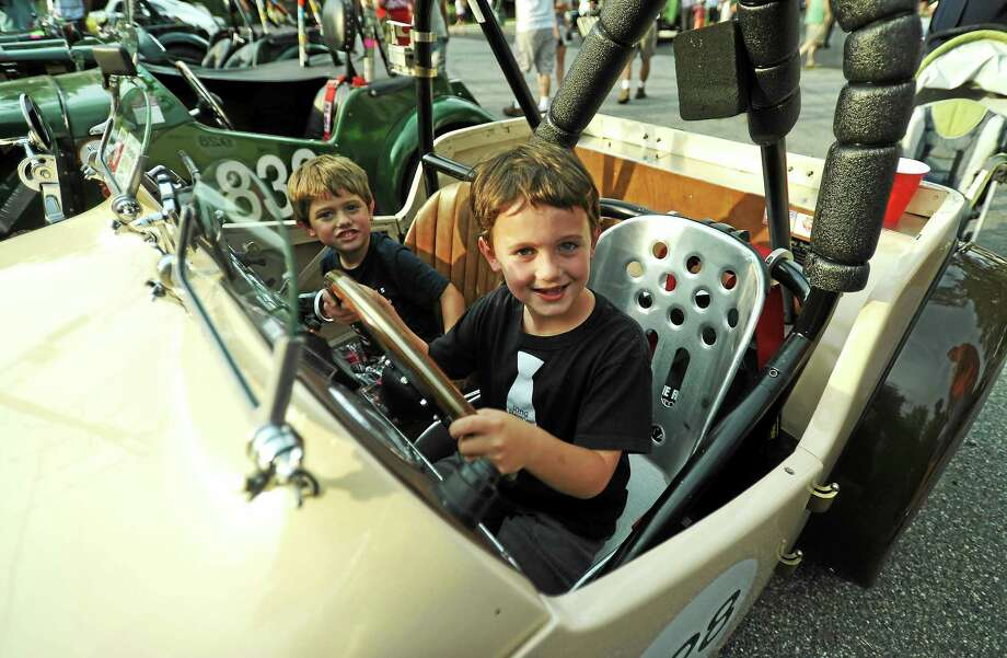 From left, Rowan Nelson, 4, and Finley Nelson, 7, of Kinderhook, New York, checks out Frank Filangeri's 1951 MG-TD. Photo: John Fitts — The Register Citizen