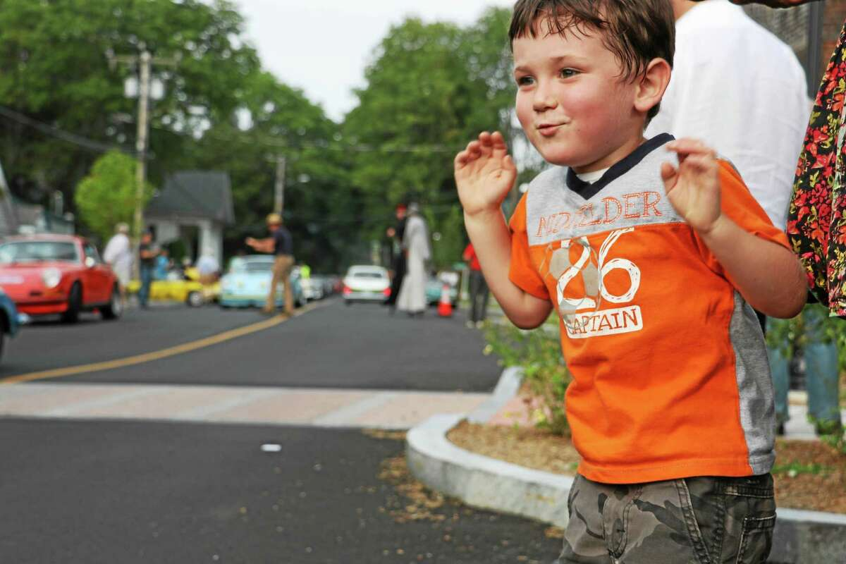 Owsley Chappuis, 4, of Washington, shows his excitment at the event. The young boy is quite the car enthusiast.