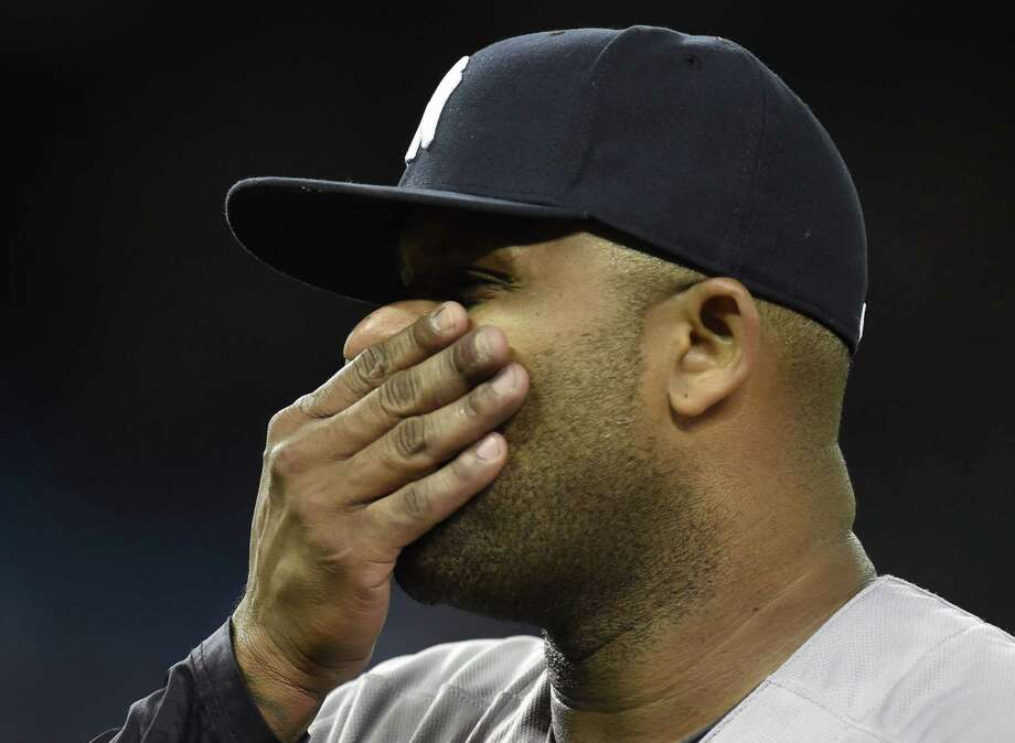 Yankees starter CC Sabathia reacts as he is pulled from the game against the Toronto Blue Jays during seventh inning on Wednesday. The Blue Jays won 5-1. Photo: Frank Gunn — The Canadian Press Via AP  / CP