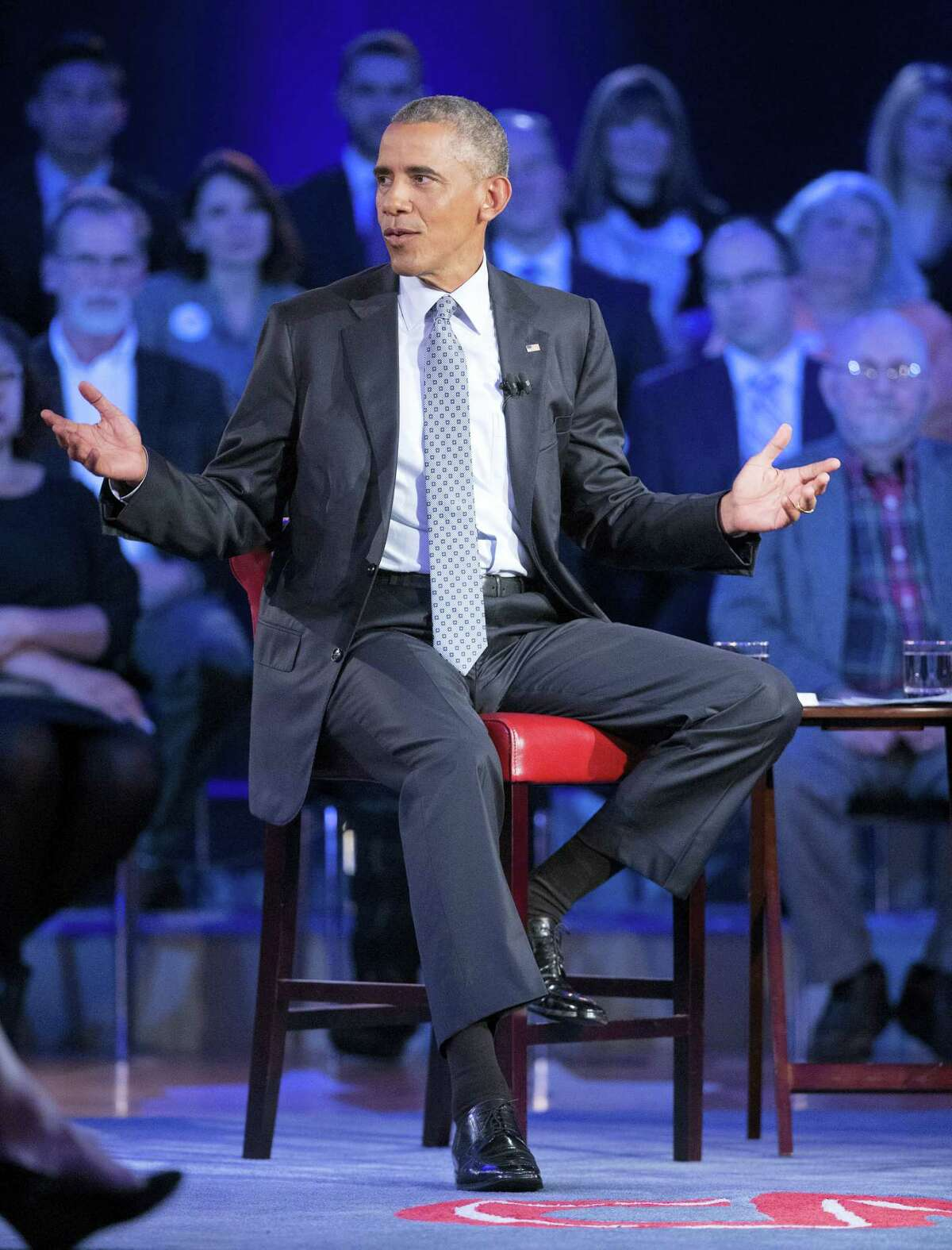 President Barack Obama answers questions during a CNN televised town hall meeting at George Mason University in Fairfax, Va., Thursday, Jan. 7, 2016. Obama's proposals to tighten gun controls rules may not accomplish his goal of keeping guns out of the hands of would-be criminals and those who aren't legally allowed to buy a weapon. In short, that's because the conditions he is changing by executive action are murkier than he made them out to be.