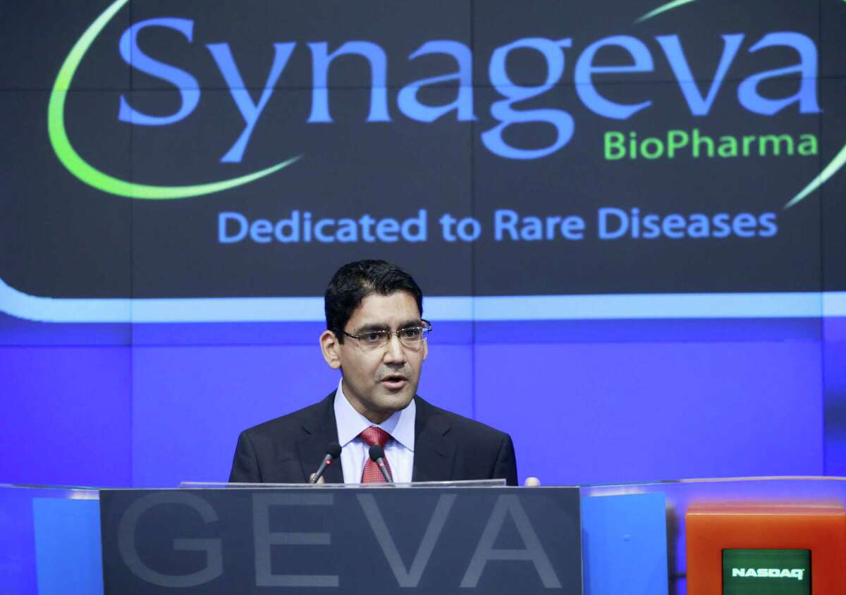 In this Nov. 3, 2011 photo, Sanj Patel, President and CEO of Synageva BioPharma Corp., attends the opening bell ceremony at Nasdaq in New York. Alexion Pharmaceuticals on May 6, 2015 announced it is spending $8.4 billion to buy fellow rare disease treatment maker Synageva BioPharma, a company with no products on the market.