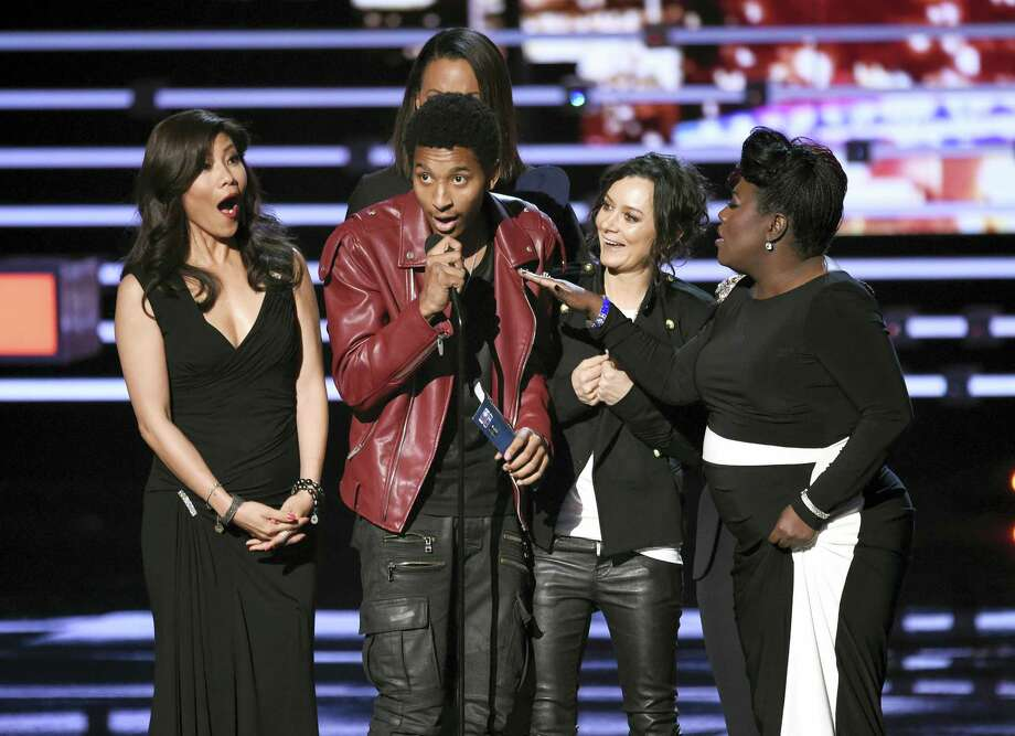 """An unidentified guest speaks on stage while Julie Chen, Aisha Tyler, and Sheryl Underwood accept the award for favorite daytime TV hosting team for """"The Talk"""" at the People's Choice Awards at the Microsoft Theater Wednesday in Los Angeles. Photo: Photo By Chris Pizzello/Invision/AP  / Invision"""