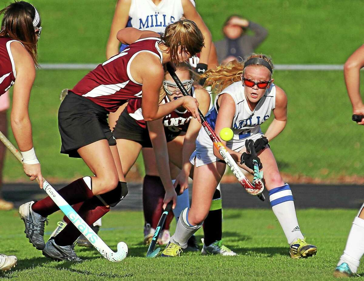 Lewis Mills took down Canton, shown here, on its way to the CIAC Class S state field hockey championship last year.