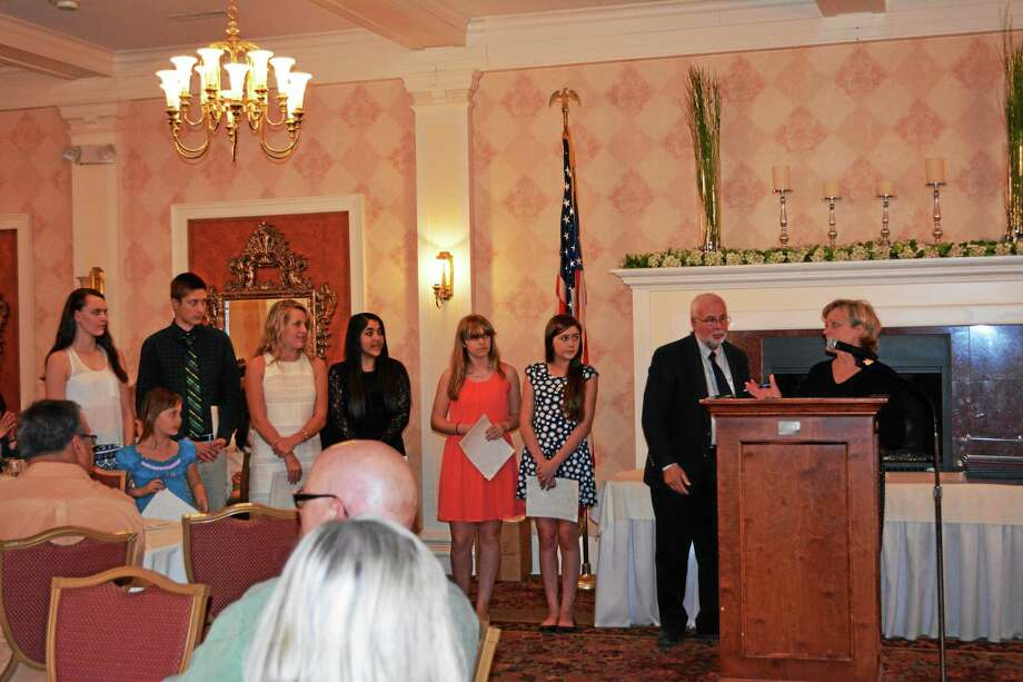 Torrington Mayor Elinor Carbone presented awards to students from several city schools at the Elks National Youth Service Day ceremony on Tuesday evening. Photo: Amanda Webster — The Register Citizen