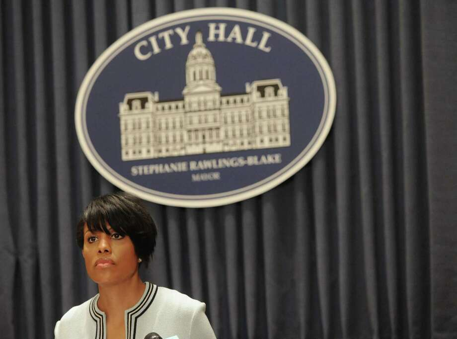 Mayor Stephanie Rawlings-Blake holds a news conference on Wednesday, May 6, 2015 in Baltimore.  The mayor called on U.S. government investigators to look into whether this city's beleaguered police department uses a pattern of excessive force or discriminatory policing. Rawlings-Blake's request came a day after new Attorney General Loretta Lynch visited the city and pledged to improve the police department.  (Kim Hairston/The Baltimore Sun via AP)  WASHINGTON EXAMINER OUT Photo: AP / The Baltimore Sun