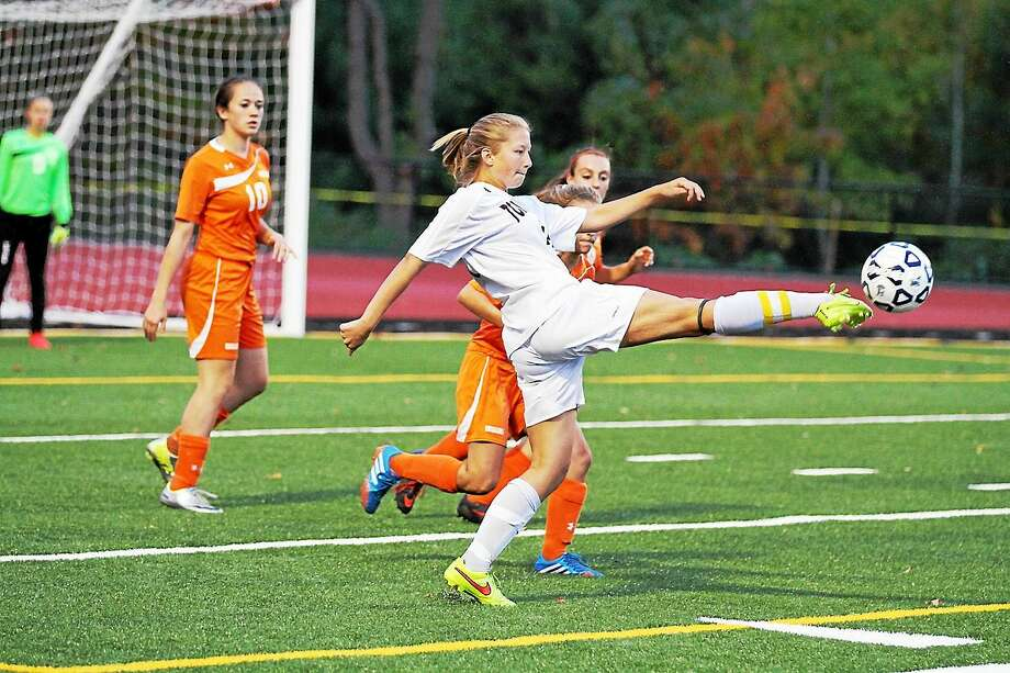 Torrington's Emily Manchester reaches for a pass in her team's loss to Watertown last season at Torrington's Robert Frost complex. Photo: Marianne Killackey -- Special To Register Citizen  / 2014