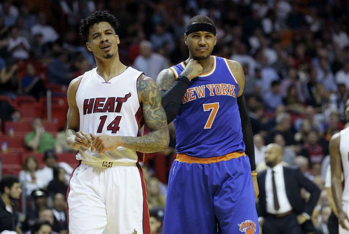 Miami Heat's Gerald Green (14) reacts after being called for a foul against New York Knicks' Carmelo Anthony (7) during the first half of an NBA basketball game, Wednesday, Jan. 6, 2016, in Miami. (AP Photo/Lynne Sladky)