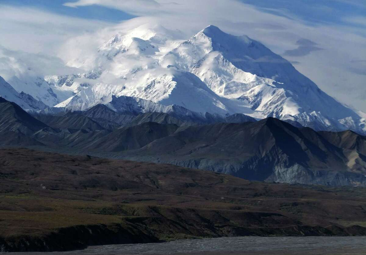This Aug. 27, 2014 file photo shows Mount McKinley in Denali National Park and Preserve, Alaska. President Barack Obama on Sunday, Aug. 30, 2015, said he's changing the name of the tallest mountain in North America from Mount McKinley to Denali.