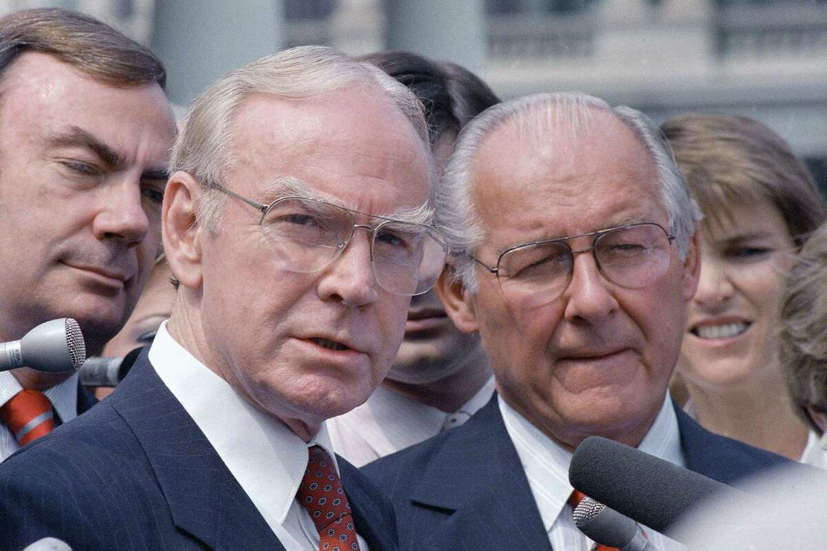 FILE - In this Aug. 5, 1987 file photo, then-House Speaker Jim Wright of Texas, left, and then-House Minority Leader Robert Michel of Ill. speak to reporters outside the White House in Washington. Wright, a veteran Texas congressman who was the first House speaker in history to driven out of office in midterm, has died. He was 92.