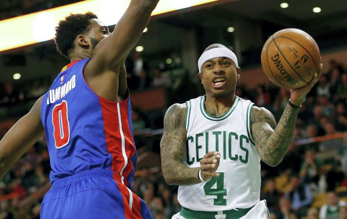 Boston Celtics' Isaiah Thomas (4) passes off in front of Detroit Pistons' Andre Drummond (0) during the first quarter of an NBA basketball game in Boston, Wednesday, Jan. 6, 2016. (AP Photo/Michael Dwyer)