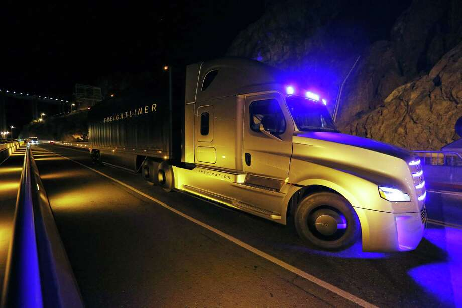 Freightliner unveils its Inspiration self-driving truck during an event at the Hoover Dam Tuesday, May 5, 2015, near Boulder City, Nev. Photo: (AP Photo/John Locher) / AP