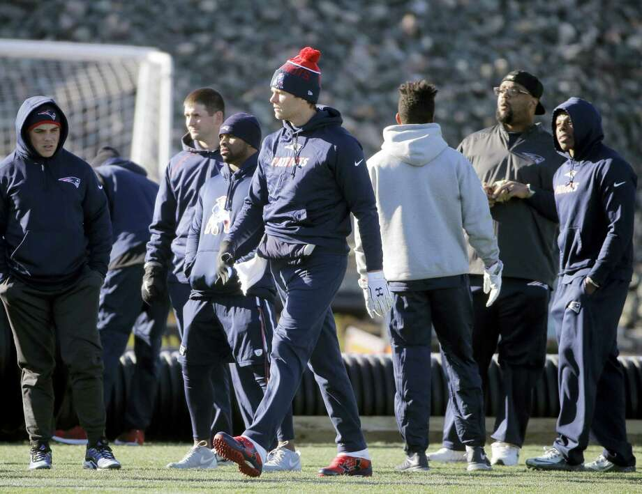 New England Patriots quarterback Tom Brady, center, walks onto the field at the start of an NFL football practice, Wednesday, Jan. 6, 2016, in Foxborough, Mass. The Patriots are to host an NFL divisional playoff game Jan. 16, 2016 in Foxborough, Mass.  (AP Photo/Steven Senne) Photo: AP / AP