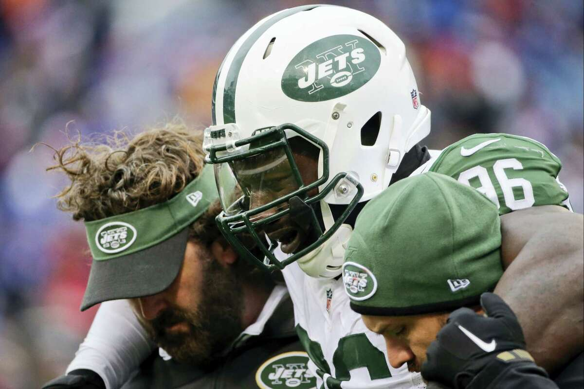 New York Jets defensive end Muhammad Wilkerson (96) is helped off the field after being hurt on a play during the second half of an NFL football game against the Buffalo Bills Sunday, Jan. 3, 2016, in Orchard Park, N.Y. (AP Photo/Bill Wippert)
