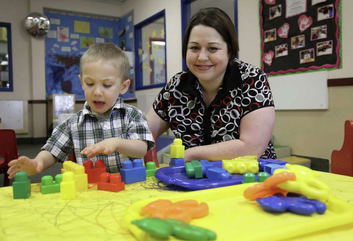 Kelly Andrus plays with her son Bradley, in his classroom at Children's Choice Learning Centers Inc., in Lewisville, Texas. Bradley has been diagnosed with mild autism.