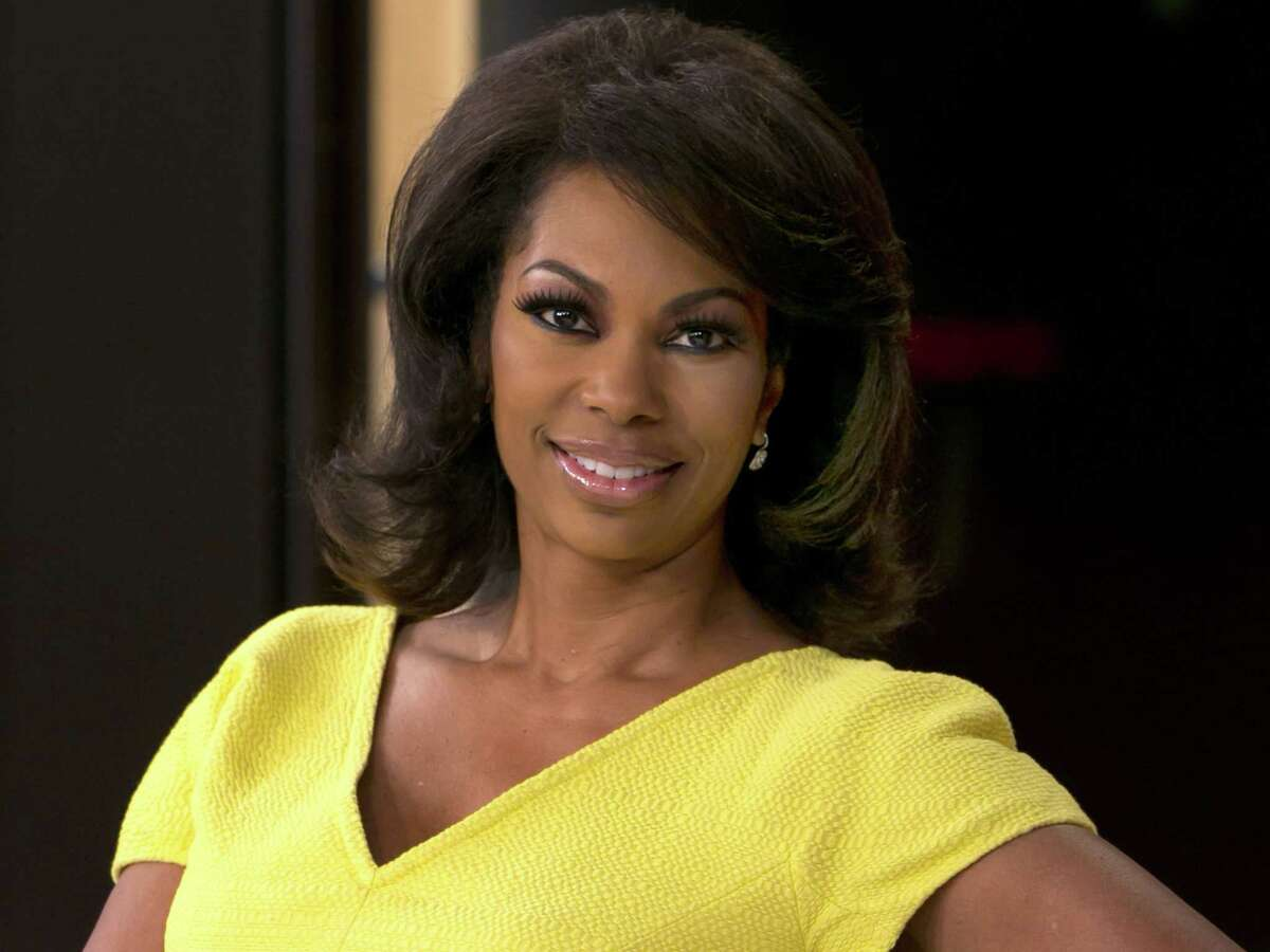 """In this April 28, 2015, file photo, Fox News anchor Harris Faulkner poses for a photo on the set in New York. Harris sued toymaker Hasbro Monday, Aug. 31, 2015, in federal court in New Jersey for more than $5 million over a toy that shares her name. Harris' suit claims Hasbro wrongfully appropriated her name and persona with its plastic """"Harris Faulkner"""" hamster."""