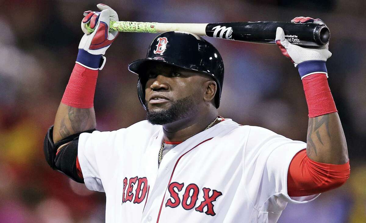 Boston Red Sox designated hitter David Ortiz rests his bat on his helmet after grounding out with two men on base during the second inning against the Baltimore Orioles at Fenway Park Tuesday. The Orioles won 6-3.
