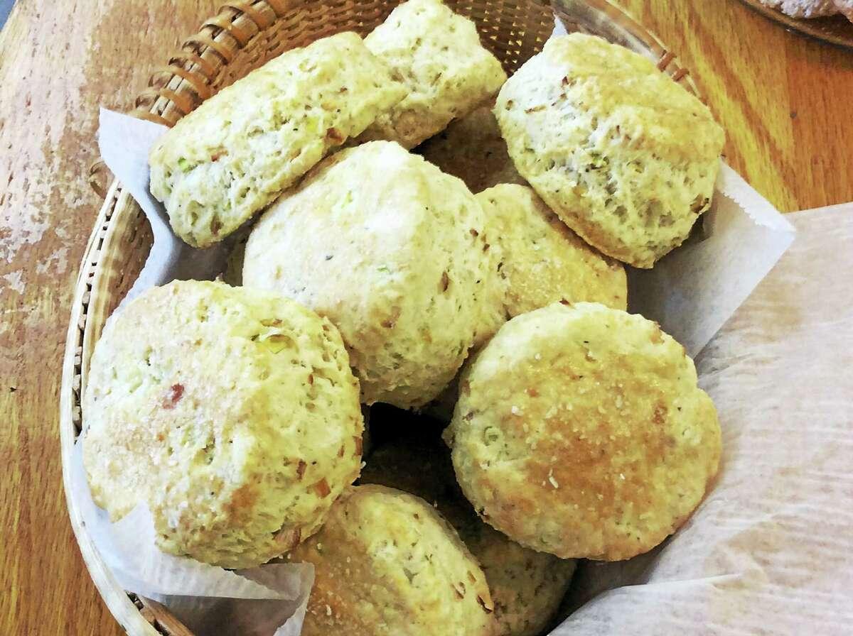 A basket of freshly baked leek and black pepper biscuits.