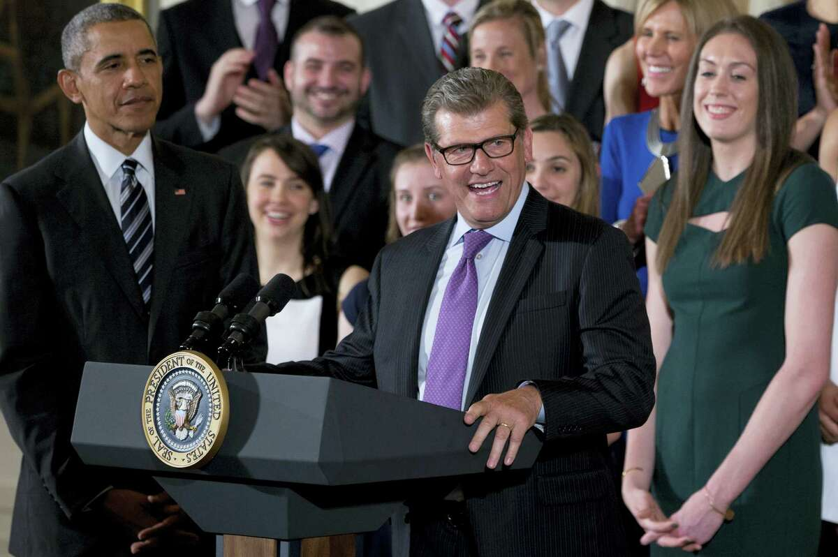 President Barack Obama and UConn forward Breanna Stewart, right, stand as UConn women's basketball coach Geno Auriemma speaks during a ceremony in the East Room of the White House in Washington, Tuesday to welcome the 2016 NCAA champion for the fourth straight year.