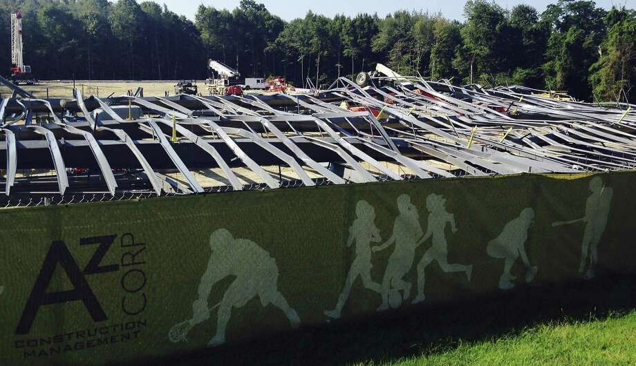Bent steel covers a construction site where an athletic practice facility being built on the Bryant University campus collapsed Tuesday in Smithfield, R.I. Workers were installing steel beams on the new facility around 8:15 a.m., when the beams collapsed, university spokeswoman Elizabeth O'Neil said. Photo: Associated Press  / AP