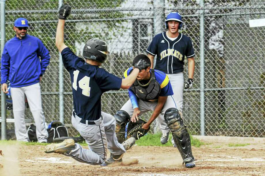 Wildcat Paul Cisowsky slides home for his second run in two innings in Wolcott Tech's 17-4 win over Harding Tuesday afternoon at Wolcott Tech. Photo: Photo By Marianne Killackey  / 2015
