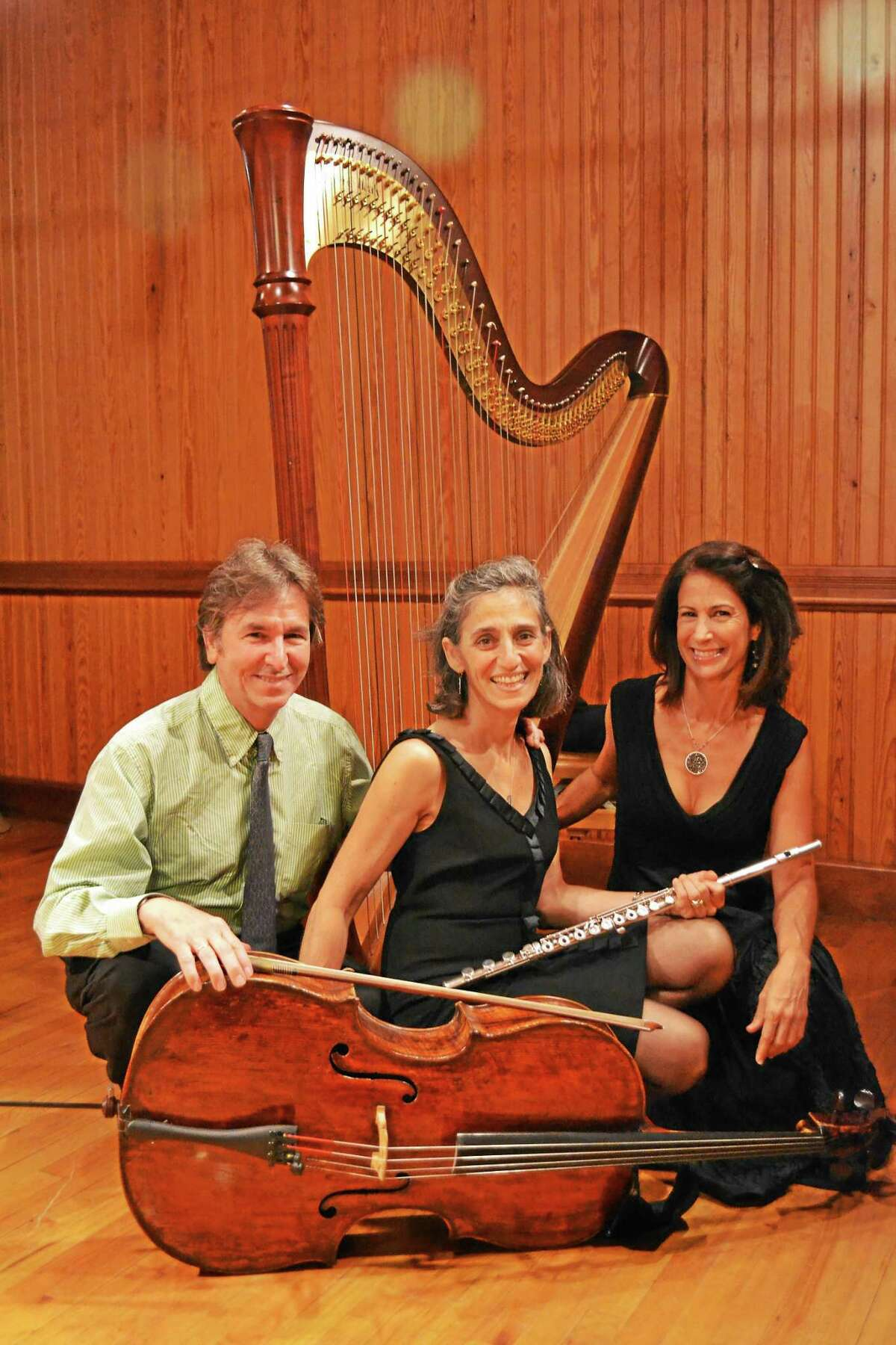 Photo courtesy of the Sherman Chamber Ensemble Above, from left, Sherman Chamber Ensemble Artistic Director and cellist, Eliot Bailen with flutist Susan Rotholz and harpist Stacey Shames.