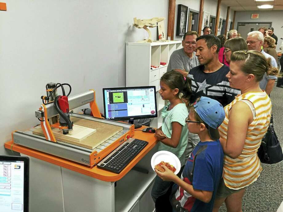 Stepcraft, a company that links Torrington and Germany, held an open house and ribbon-cutting Friday. Photo: Ben Lambert — The Register CitizEn