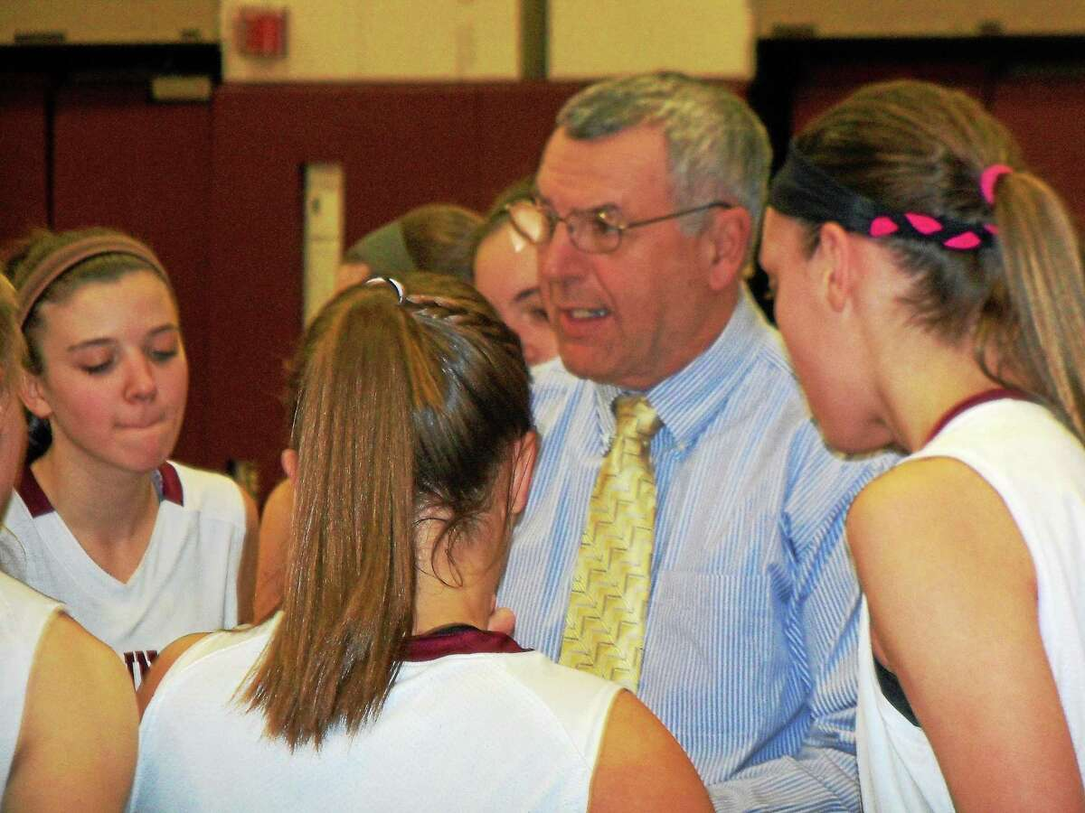 Torrington coach Mike Fritch talks strategy to his team during a game against Crosby Tuesday night.