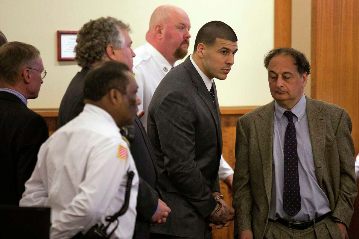 Former New England Patriots football player Aaron Hernandez stands up after he is sentenced to life in prison at the Bristol County Superior Court in Fall River, Mass., on April 15, 2015. Hernandez was found guilty of first-degree murder in the shooting death of Odin Lloyd in June 2013.