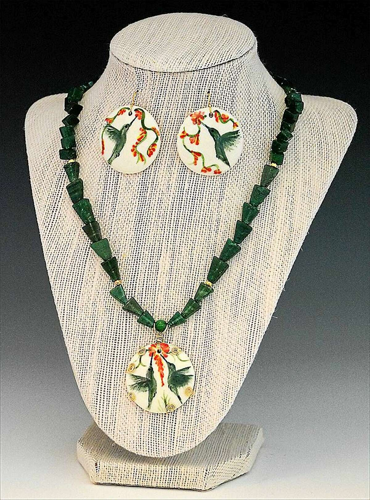 Contributed photo Jewelry by Roxbury ceramic artist Judith Taylor, consisting of hand-painted ceramic hummingbird pendant on aventurine necklace with matching earrings.