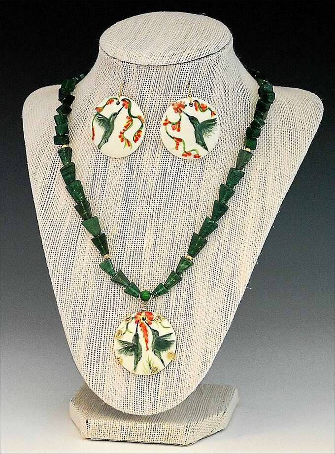 Contributed photo  Jewelry by Roxbury ceramic artist Judith Taylor, consisting of hand-painted ceramic hummingbird pendant on aventurine necklace with matching earrings. Photo: Journal Register Co.