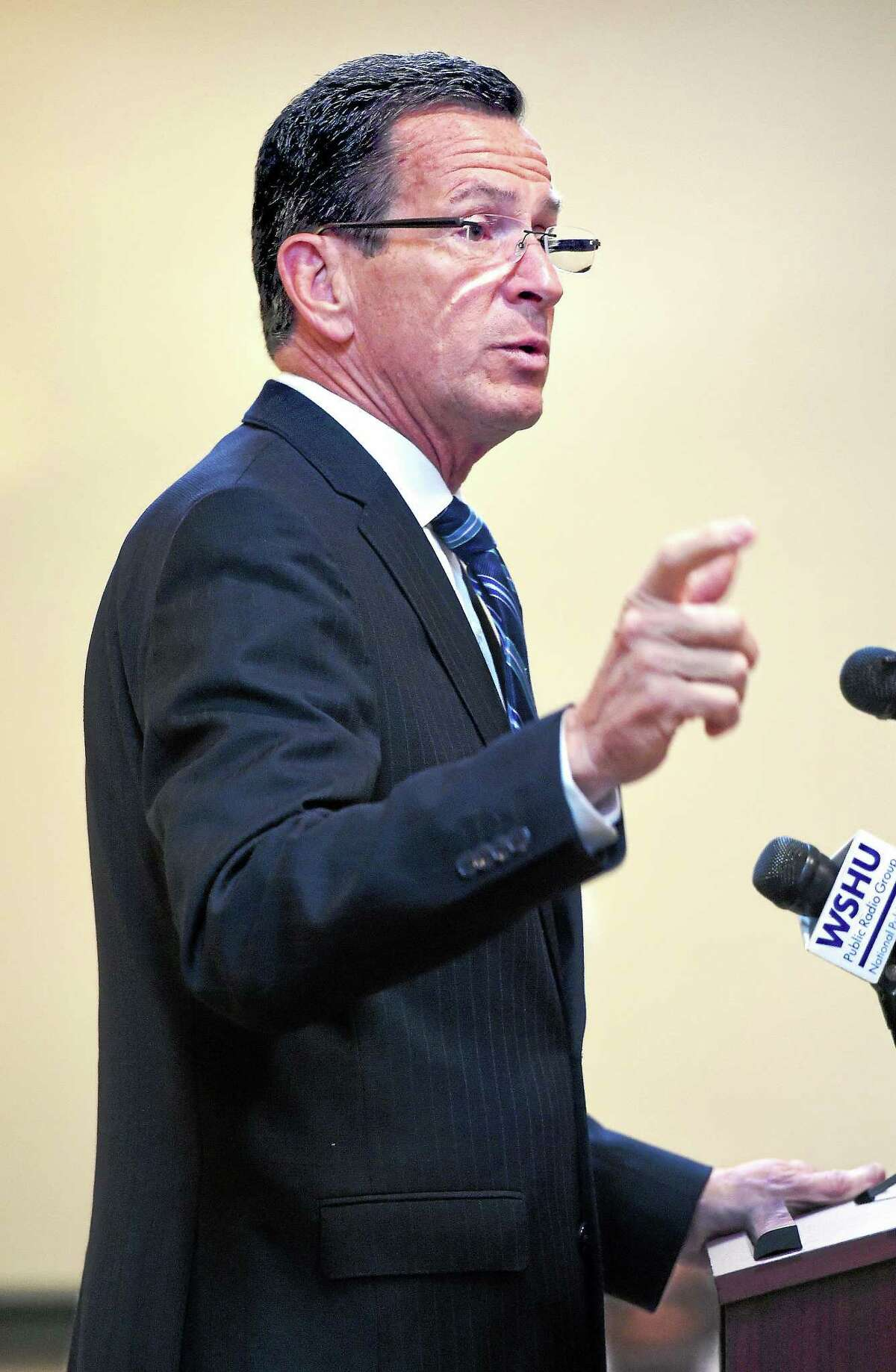 In this Sept. 15, 2014 file photo, Gov. Dannel P. Malloy speaks at a transportation forum in North Haven.