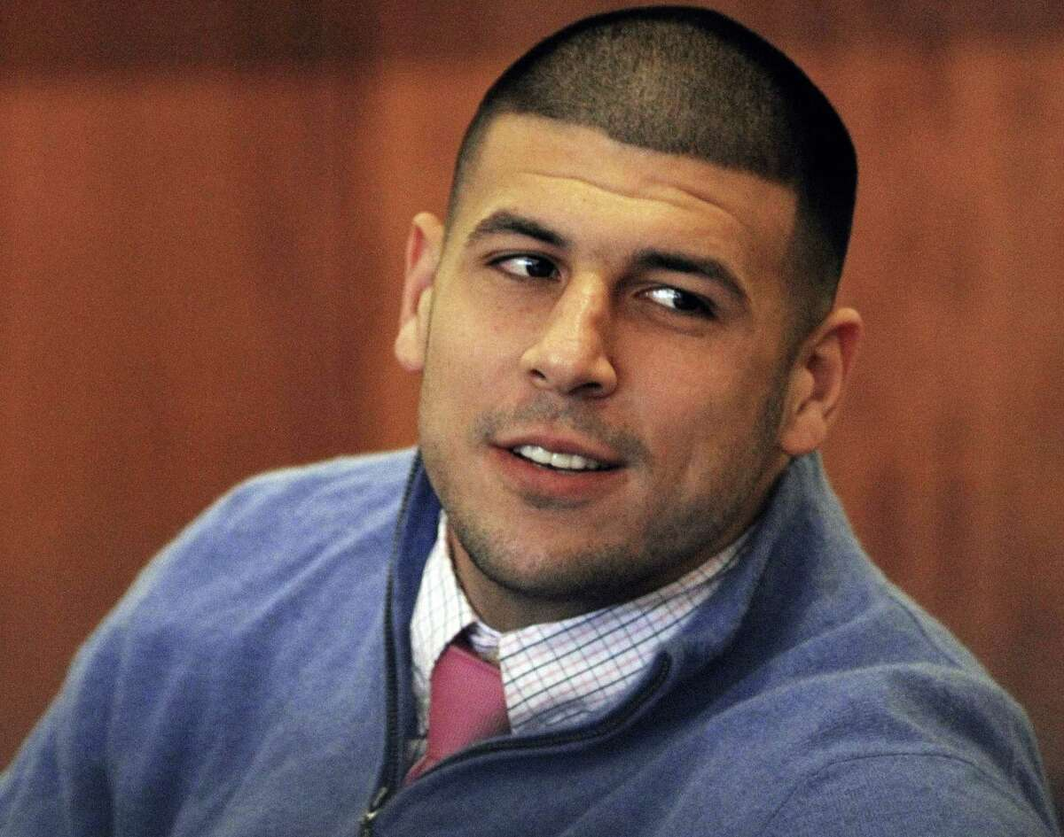 In this Oct. 1, 2014 file photo, former New England Patriots football player Aaron Hernandez looks back during an evidentiary hearing at Fall River Superior Court in Fall River, Mass.