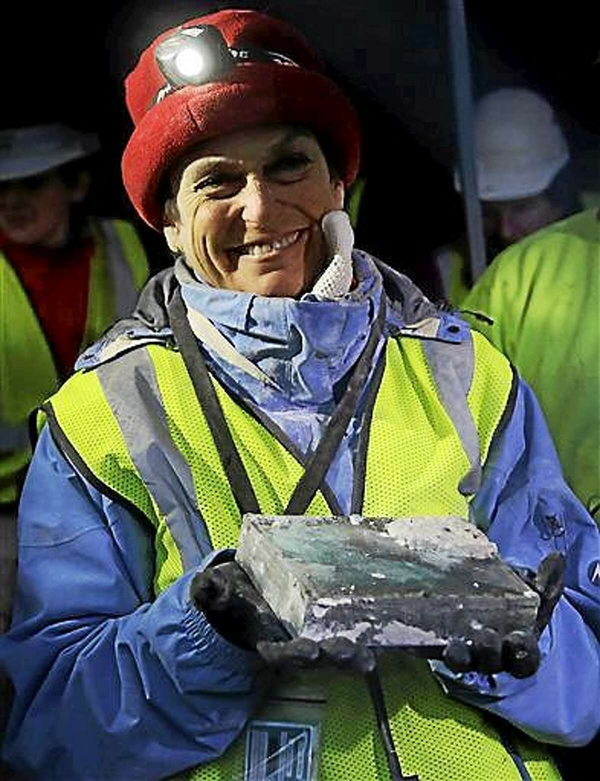 Pamela Hatchfield, a conservator at the Boston's Museum of Fine Arts, holds a time capsule she removed Dec. 11 from the cornerstone of the Statehouse in Boston.