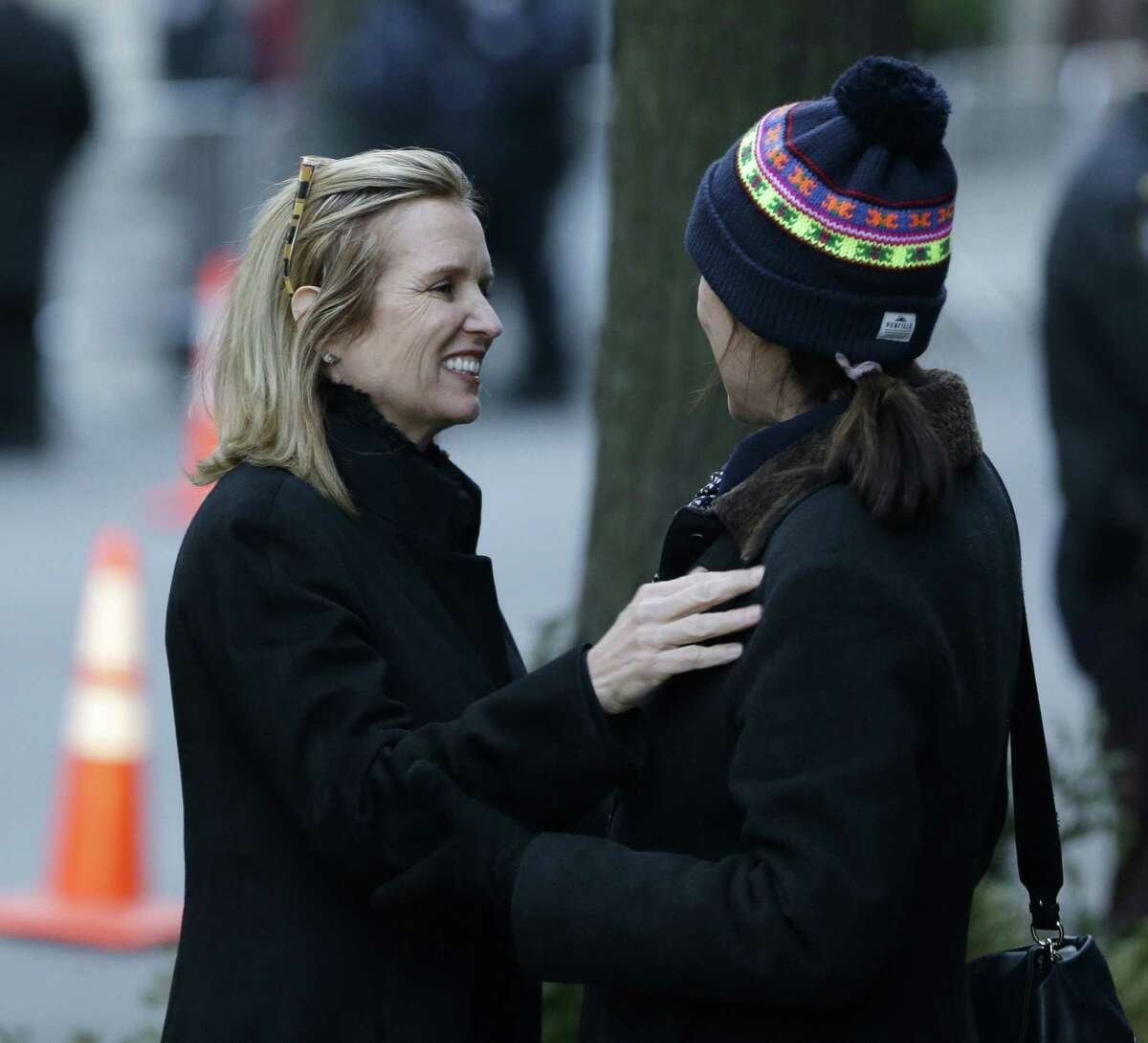 Kerry Kennedy, former wife of New York Governor Andrew Cuomo, greets an unidentified woman outside the wake for Mario Cuomo in New York, Monday, Jan. 5, 2015. Mario Cuomo, 82, died in his Manhattan home on Thursday, Jan. 1, just hours after his son was inaugurated for a second term. (AP Photo/Seth Wenig)