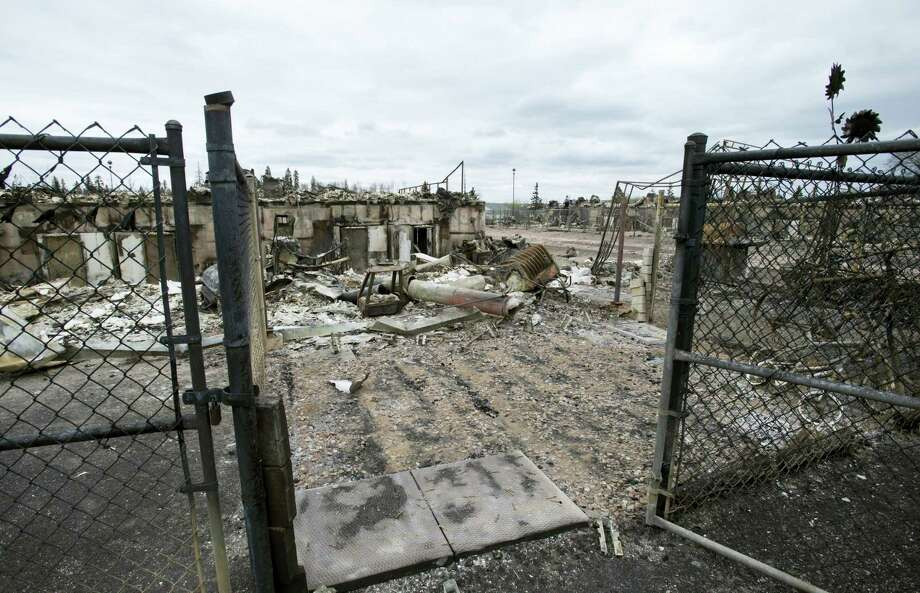 The burnt remains of a home is viewed in the Abasands neighborhood during a media tour of the city of Fort McMurray, Alberta, Monday, May 9, 2016. A break in the weather has officials optimistic they have reached a turning point on getting a handle on the massive wildfire. Photo: Jonathan Hayward — The Canadian Press Via AP   / CP