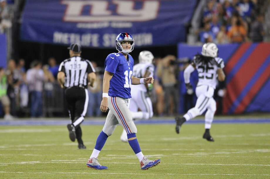 New York Giants quarterback Eli Manning reacts after throwing an interception during a preseason game against the New York Jets on Saturday in East Rutherford, N.J. Photo: Bill Kostroun — The Associated Press  / FR51951 AP