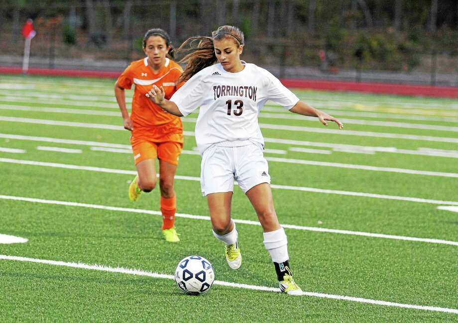 Torrington's girls soccer team held Watertown, shown here, to an overtime loss last year, but the Indians and other Iron Division opponents Naugatuck and Woodland, promise to be stronger than ever. Photo: Marianne Killackey — Register Citizen  / 2014