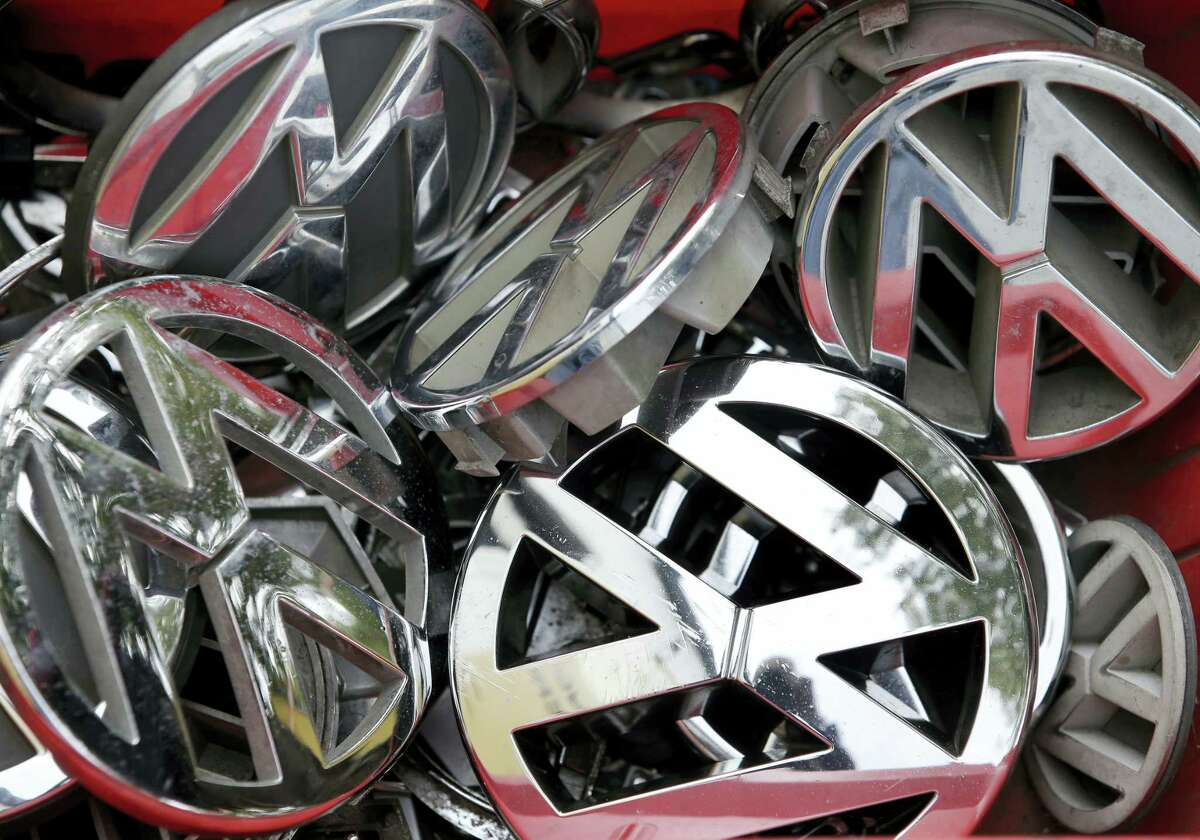 In this Sept. 23, 2015 photo, Volkswagen ornaments sit in a box in a scrap yard in Berlin, Germany.