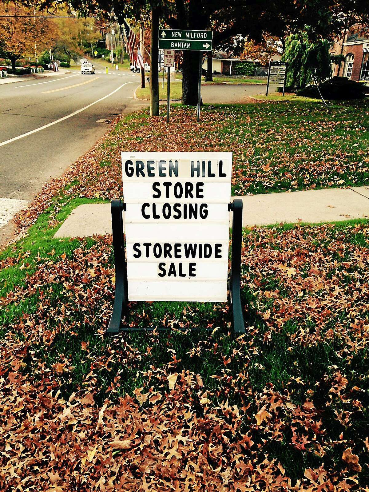 A sign announces a business closing in Washington, Conn.