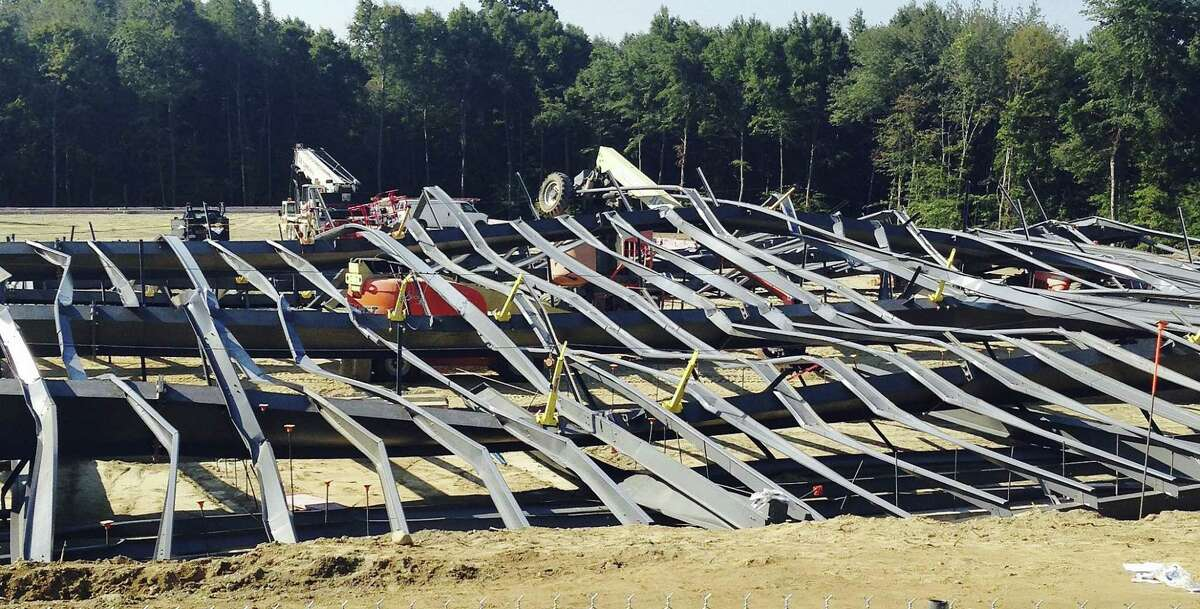 Bent steel covers a construction site where an athletic practice facility being built on the Bryant University campus collapsed Tuesday, Sept. 1, 2015, in Smithfield, R.I. Workers were installing steel beams on a new indoor practice facility around 8:15 a.m. when the beams collapsed, university spokeswoman Elizabeth OíNeil said.